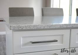 i love the look of carrara marble countertops and white cabinets but during our quest for the right countertops we learned that quartz and granite are