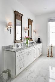 Traditional White Bathrooms This Traditional White Master Bathroom Features White Shaker Style