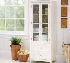 bathroom storage cabinets. White Tall Narrow Storage Cabinet With Stylish Wicker Basket For Classic Bathroom Ideas Glass Windows Cabinets B