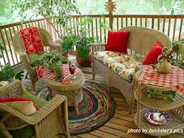 creative round rug design on back porch with wicker porch furniture