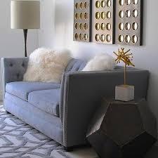gray velvet tufted sofa with white mongolian pillows view full size