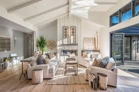 marvellous farmhouse living room decor brown rectangle rug wooden floor white sofa white armchair wooden coffee