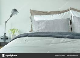 gray color scheme bedding in modern classic style bedroom stock photo