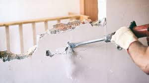 how to safely knock down a wall