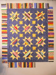 string-pieced quilt | abyquilts & I sewed the units together and added a few 5″ strips at the ends to make  them long enough. And then I sewed the borders to the quilt. Adamdwight.com