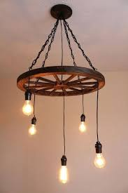 wagon wheel light gorgeous wagon wheel chandelier best ideas about wagon wheel light on wagon wheel wagon wheel