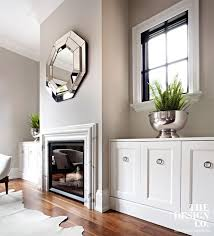 white built ins custom cabinetry marble fireplace surround mirror above fireplace