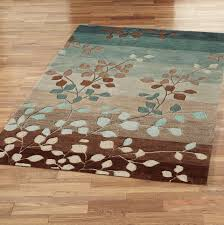 brown area rug with leaves