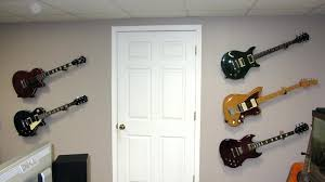 images of guitars hanging on wall guitar wall mounts talk forum