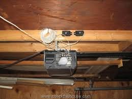 garage door opener safety sensors improperly installed above the opener at ceiling level