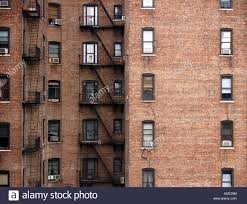 brick apartment buildings. brick walls and windows on apartment buildings in manhattan new york city. t