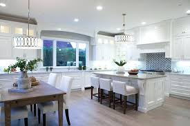 white cabinets with wood floors beautiful transitional kitchen with white cabinets gray granite counter dining island and wood flooring photos white kitchen