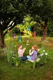 15 magical fairy gardens for kids including one kids can actually get  INSIDE. I love