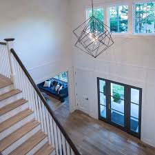 the cubist large chandelier by kelly wearstler hangs in the entry of 6 sylvan farms lane in westport ct designed built by so many incredible details
