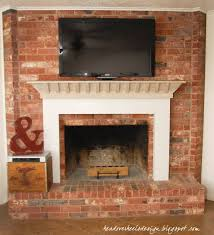 head over heels tv on a brick fireplace a whitewashed mantle makeover