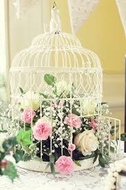 Birdcage vintage centrepieces from Peppermint Venues. Nice idea for a  flower arrangement!