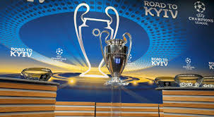 the uefa champions league trophy sits on the stage during the drawing of the for the champions league 2017 18 round of 16 at the uefa headquarters