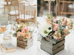 Old wooden boxes are easily available and also quite affordable. For a  rustic themed wedding it could be perfect with artistically arranged  flowers.