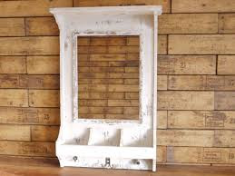 a superb distressed painted wood wall mirror