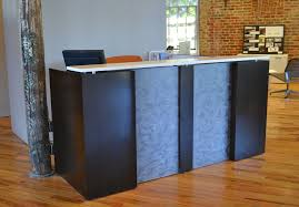 l shaped reception desk cherry veneer with 3form accent and solid surface transaction counter