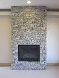 image of stacked stone fireplace installation