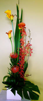 Modern #flower arrangement of Callas, Orchids, and Protea Nutans with  tropical foliages.