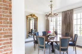 french dining room with round dining table and blue velvet french dining chairs