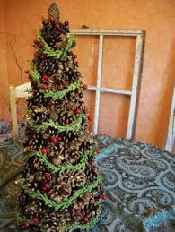 40 Creative Pinecone Crafts For Your Holiday Decorations Pine Cone Christmas Tree Craft Project