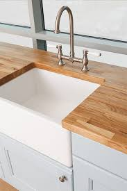 consider our oak worktops for a classic kitchen setting alongside ceramic sinks and fixtures