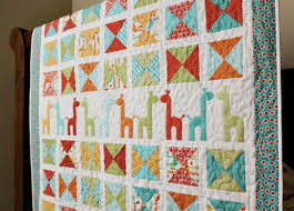 8 Sweet Baby Girl Quilt Patterns That'll Make You Swoon & colorful giraffe patterned quilt Adamdwight.com