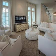 off white linen sectional with round off white ottoman