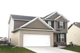 House With Black Trim Black Roof White Trim White Garage Doors Black Raised Panel