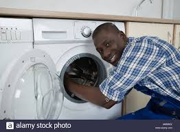 black man washing clothes. Brilliant Black Closeup Of Young Happy African Technician Fixing Washing Machine  Stock  Image Intended Black Man Clothes T