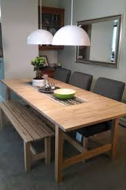 dining tables glamorous table ikea small extendable rectangle wooden with bench and three gray chairs two white half ball lamp ceiling for room wall mirro