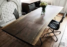 wood slab dining table beautiful: a slab of reclaimed wood makes a stunning table reminiscent of the work of mid century design icon george nakishima the natural beauty of the wood is the