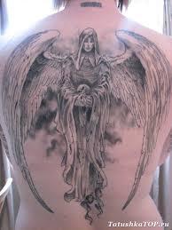 тату парящий ангел на спине эскизы татуировок