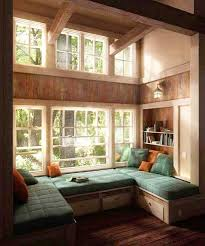 window seat with green cushions