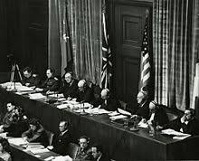 nuremberg trials  judges sitting in nuremberg from left to right volchkov nikitchenko birkett sir geoffrey lawrence biddle parker donnedieu de vabres and falco