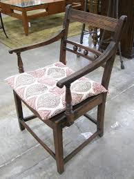 antique wood arm chair with cushion