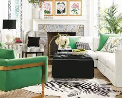 zebra print cowhide rug layered over natural fiber rug ballard designs