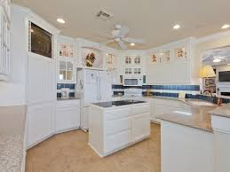 lovely ceiling fans without lights and classic table lamp with white kitchen island