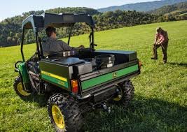 john deere gator tool box. man sitting in a green and gold gator grassy field with another working john deere tool box