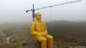 Enormous <b>golden</b> Mao <b>statue</b> built in Chinese village | News | DW ...