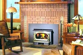installing a gas fireplace insert gs s cost to install adding line masonry fireplac a low profile gas fireplace is installed