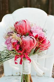Giant Proteas - Pretty awesome wedding bouquet! See more of this whimsical  wedding on #