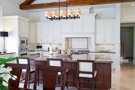 triple seated home office area. The Chairs In This Kitchen Help To Carry Contrasting Color Of Island Further Into Triple Seated Home Office Area