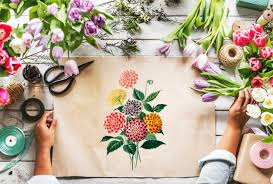 florist showing empty design space paper on wooden table with fresh flowers decorate free photo