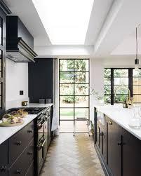 Gorgeous black kitchen with herringbone wood floors | Kitchen + ...