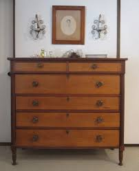 old and vintage natural maple dresser with 6 drawer and lock under wall mounted chandelier lighting ideas