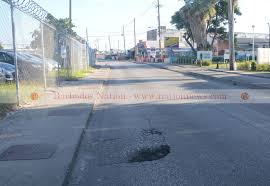 Image result for images for potholes in Barbados